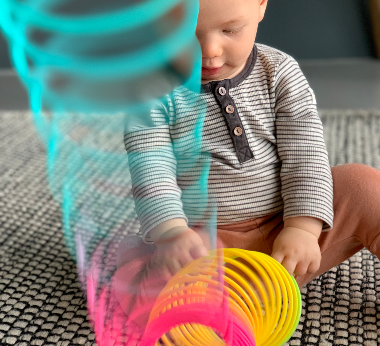 Refresh your baby's toys to help develop new motor skills